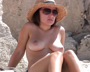 With tina, we spend a full aftenoon nude in a nudist beach. We were quite excited and I ask tina to start a long long strip (as long as the skirt is short). In a small road close to a passing road.