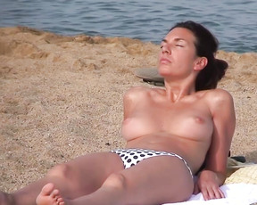 This young lady had a lovely pair of perky breasts that she showed off for us all at the plage.