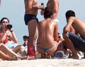 Young daughter on gran canaria plage, toghether with nude mother. A pity that the daughter kept wearing her bottom.